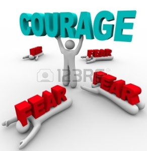 9748121-one-person-stands-holding-the-word-courage-having-conquered-his-fear-while-others-around-him-succumb